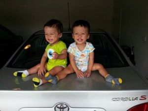 20140625 Boys on car smiling